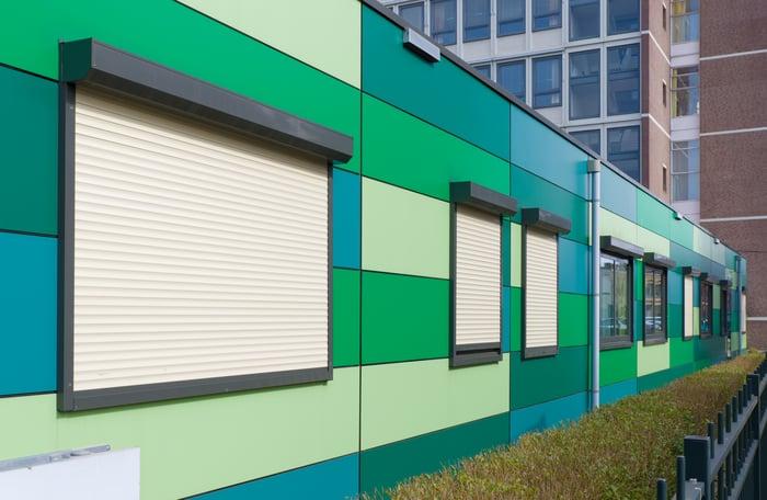 Green modular building in a city.