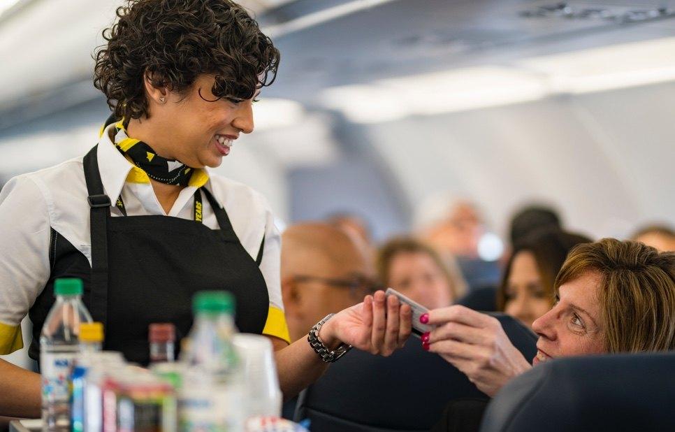 Spirit Airlines stewardess serving passenger