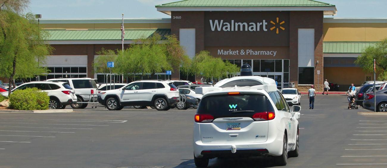 A Waymo car in a Walmart parking lot