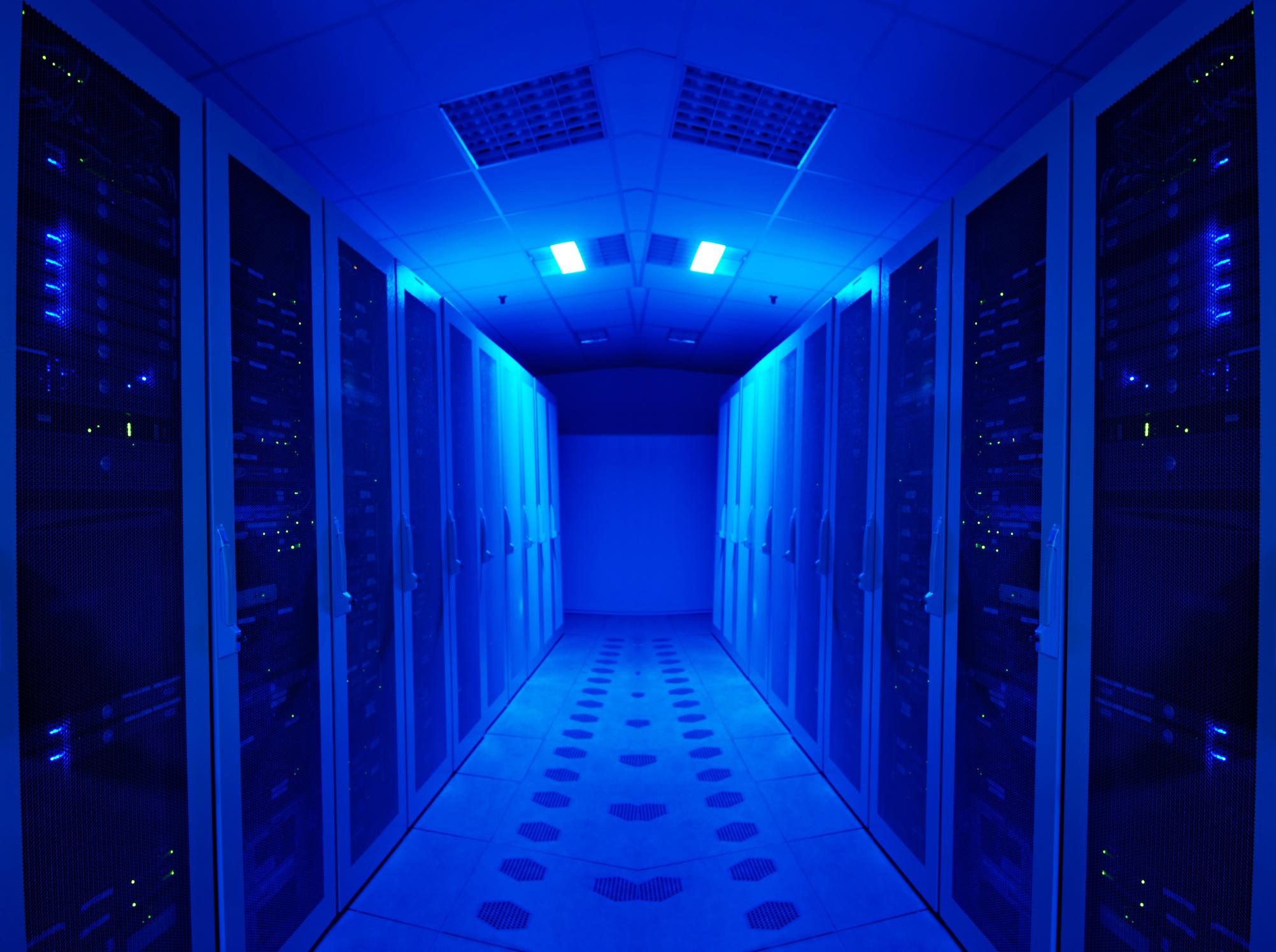 Banks of servers bathed in blue light