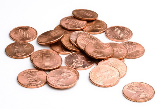 A group of U.S. pennies in a pile.