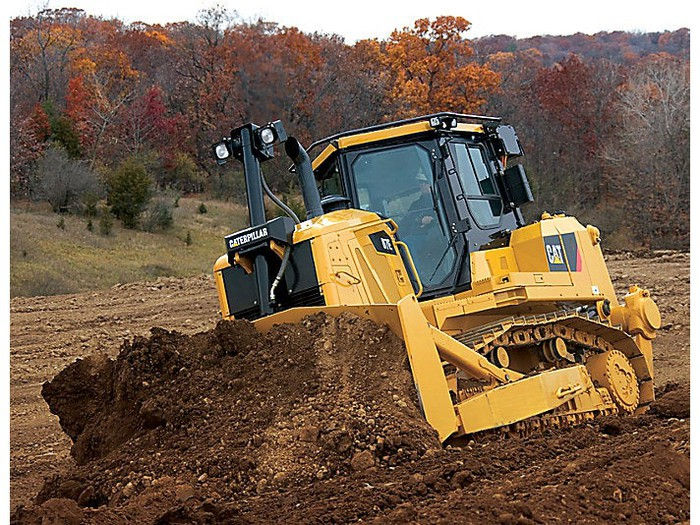Bulldozer plowing dirt