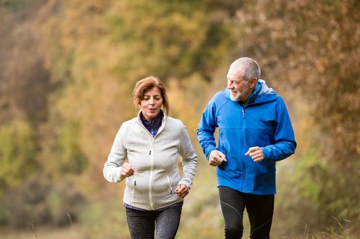 Senior couple jogging outdoors