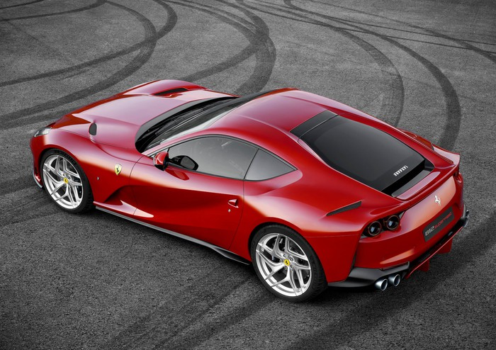 A red Ferrari 812 Superfast, a low-slung, front-engined two-seat V12-powered sports car, viewed from above