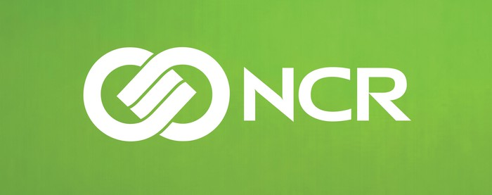 White NCR logo on a green background.