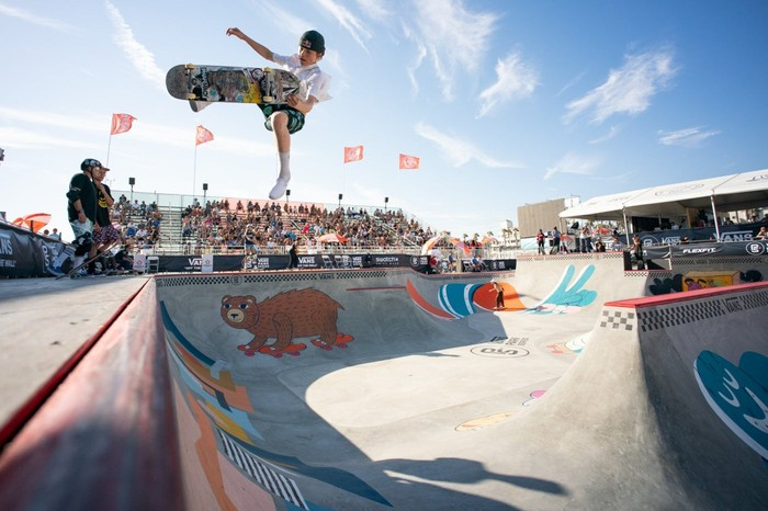 Vans-sponsored skater CJ Collins airborne in the middle of a trick.