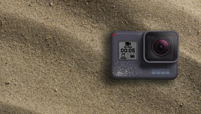 GoPro HERO5 Black camera, sitting on sand