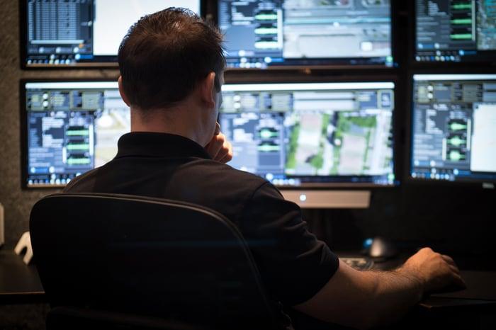 ShotSpotter employee looking at computer monitors.