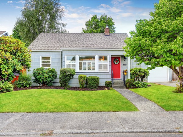 small house and front yard in suburb neighborhood