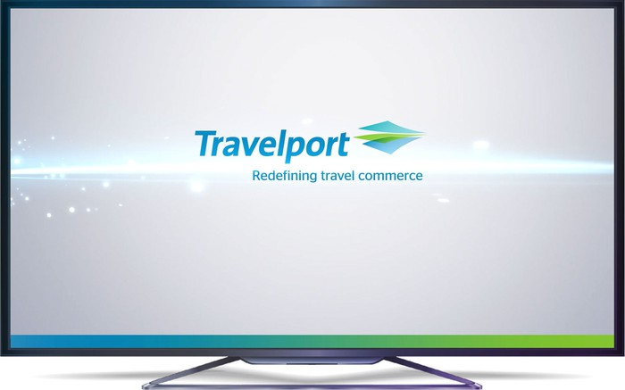 Travelport logo on a large computer monitor