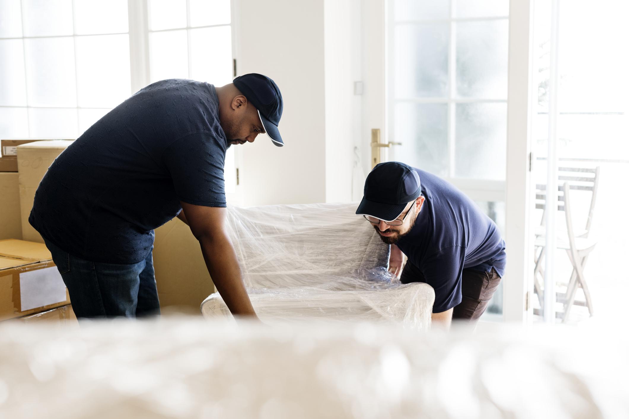 Two men delivering furniture