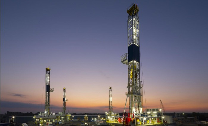 Drilling rig at sunrise.