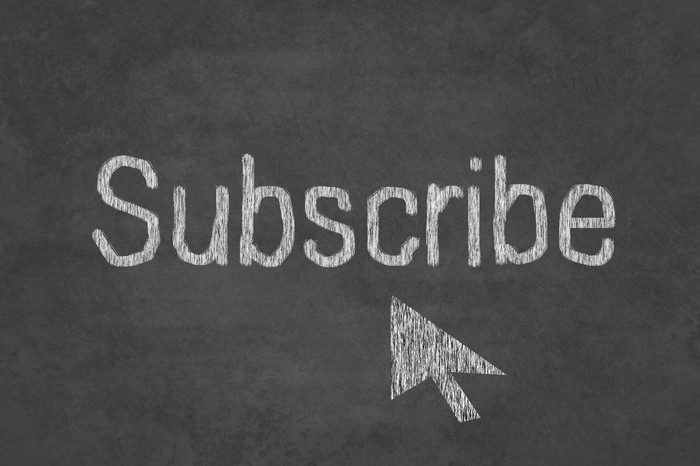 "The word ""subscribe"" on a chalkboard"