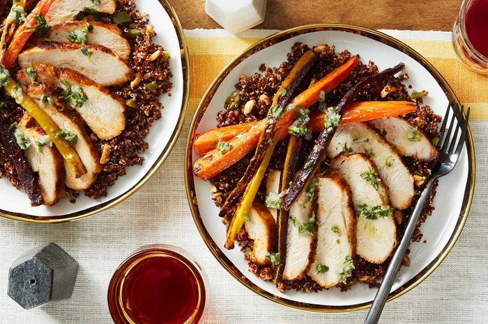 Two plates of a Blue Apron pork dish side by side.