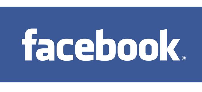 White facebook logo against a blue background.