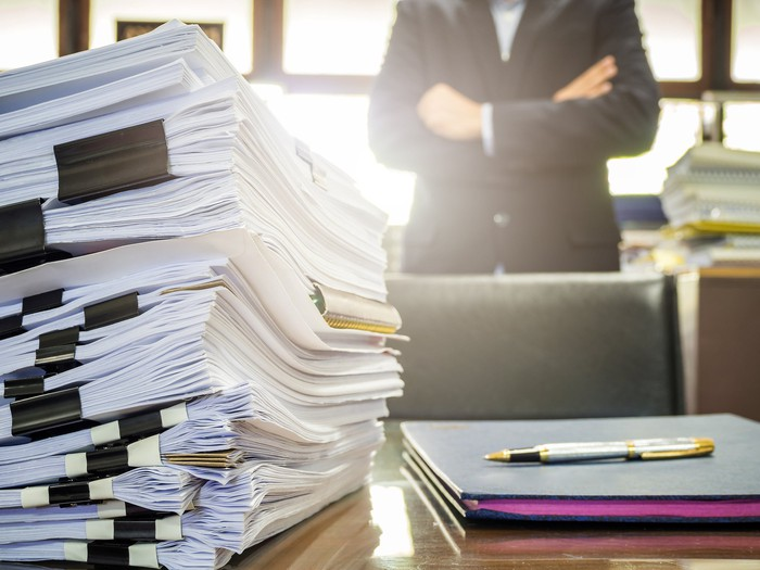 Pile of paperwork on a desk