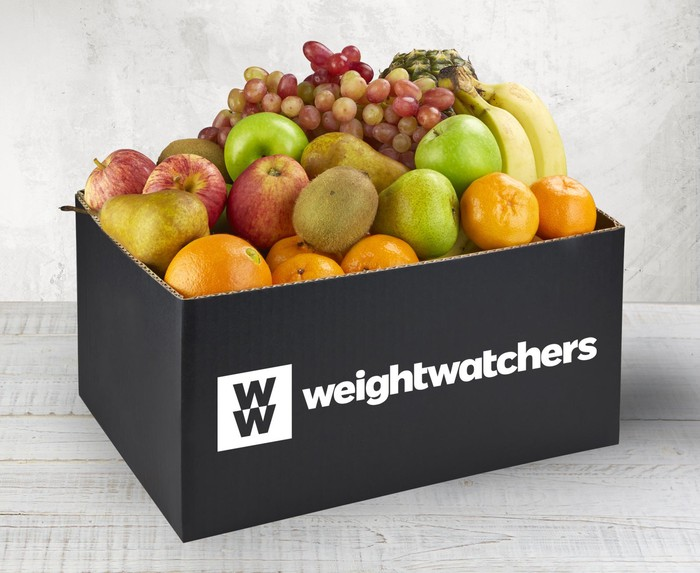 Several types of fruit in a box labeled weightwatchers.