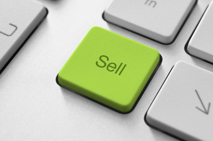 Green sell button on a keyboard.
