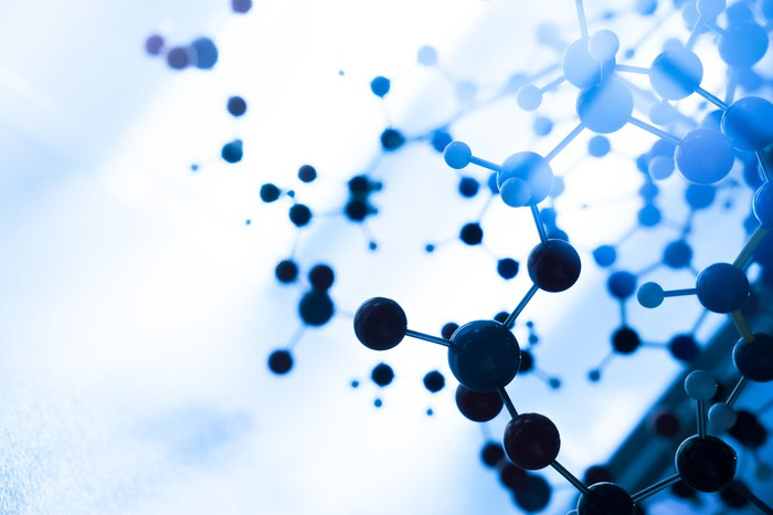 Depiction of molecules on a blue background.