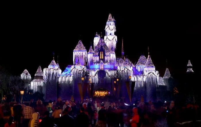 Disneyland's Sleeping Beauty Castle lit up at night.