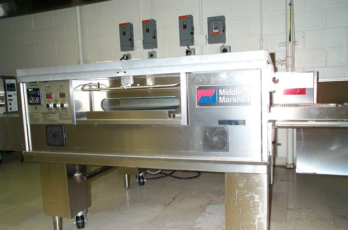 Large commercial oven labeled with Middleby brand in a kitchen.