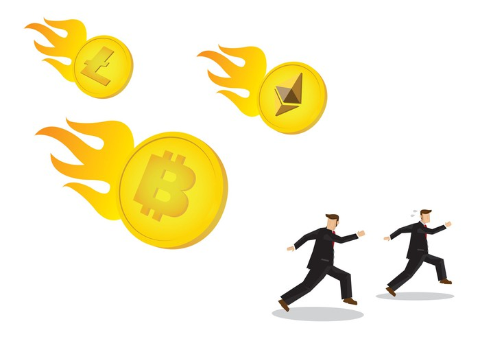 Two cartoonish businessmen running away from several incoming meteors, each showing the emblem of a popular cryptocurrency while crashing down in flames.