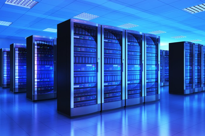 Many servers in a blue-lighted data center.