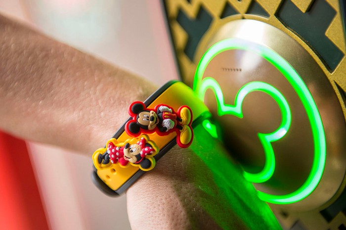 A Disneyland visitor uses a MagicBand.