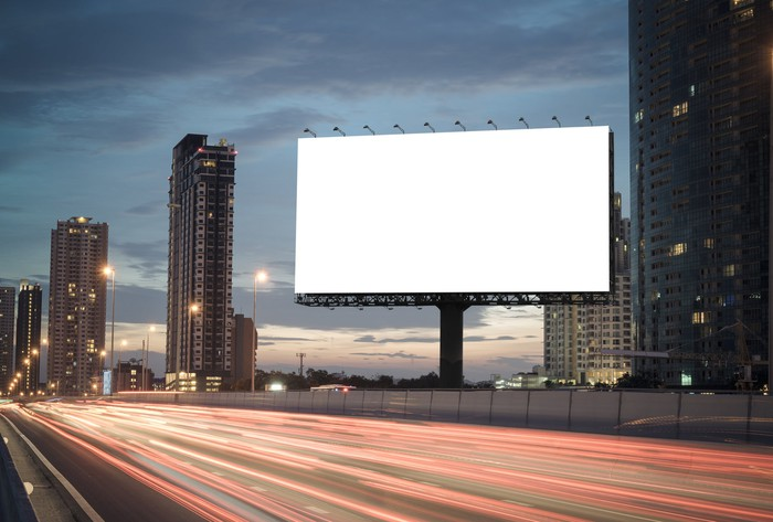 A blank billboard on the highway.