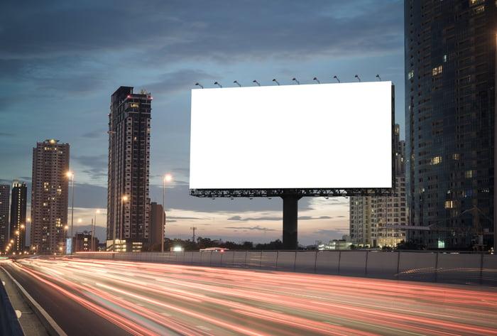 A blank billboard on the highway.