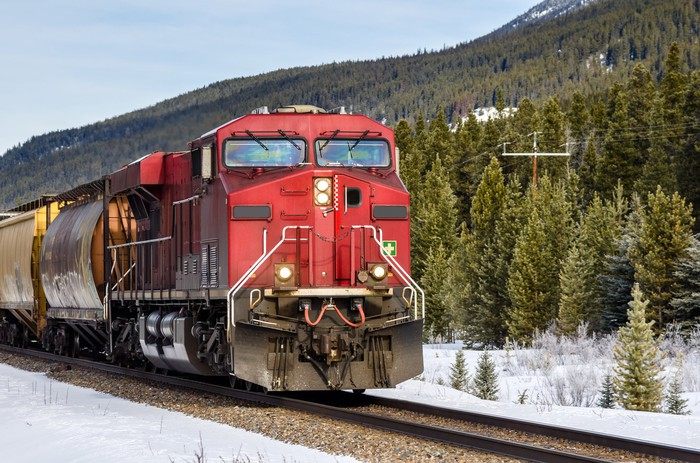 A cargo train passing through the mountains.