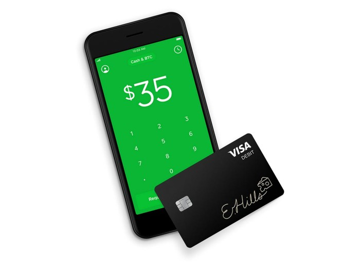 Phone displaying the Cash App, with a Cash Card next to it.
