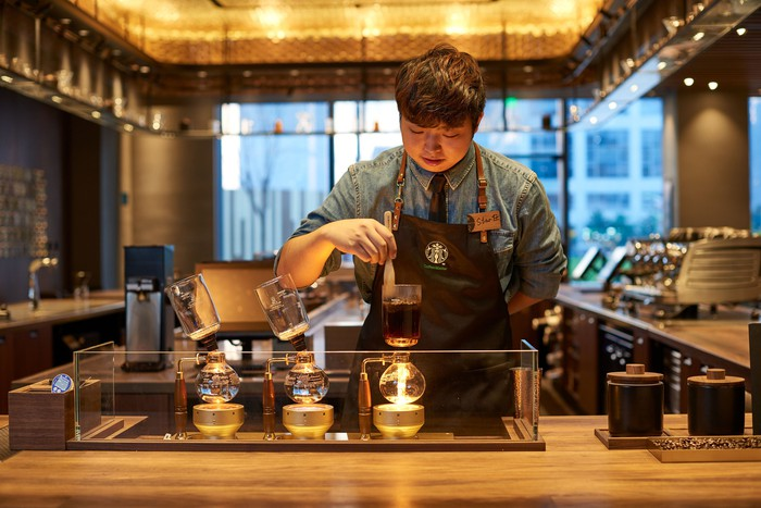 A man works in a Starbucks in China.