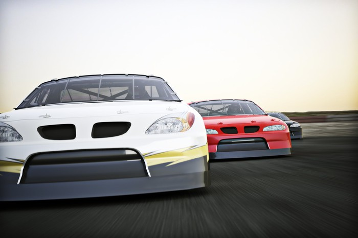 Cars racing on a track.