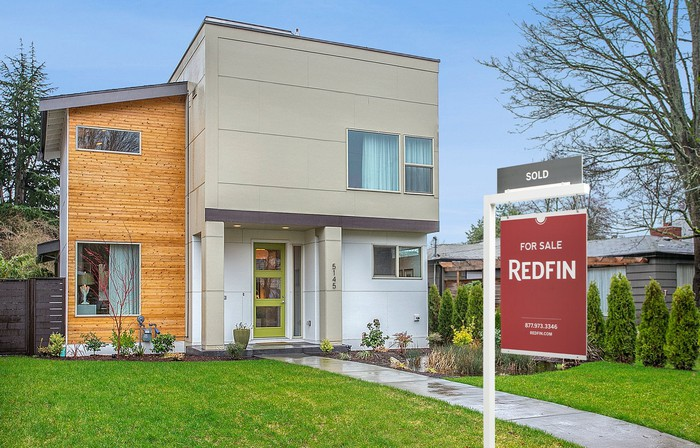 A Redfin For Sale sign in front of a house