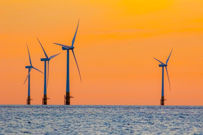 Offshore wind turbines at dawn.