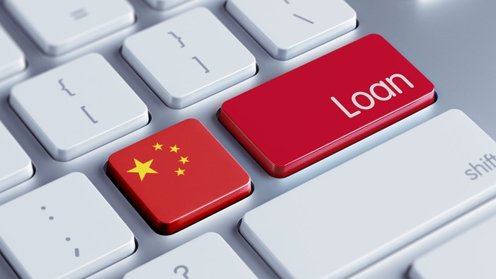 """Two buttons on a computer keyboard, displaying the Chinese flag and the word """"loan""""."""