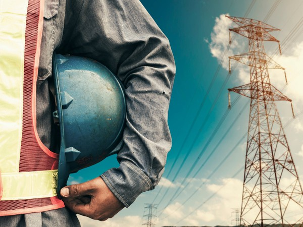 17_10_31 Man standing with power lines in background_GettyImages-642687412
