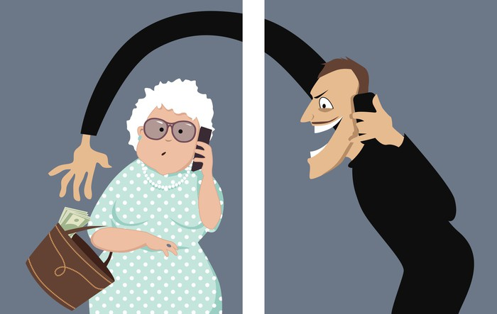 A cartoon depicts a scammer talking on a phone with a senior woman and trying to steal money out of her purse.