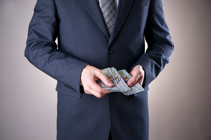 Man in a suit with money in his hands