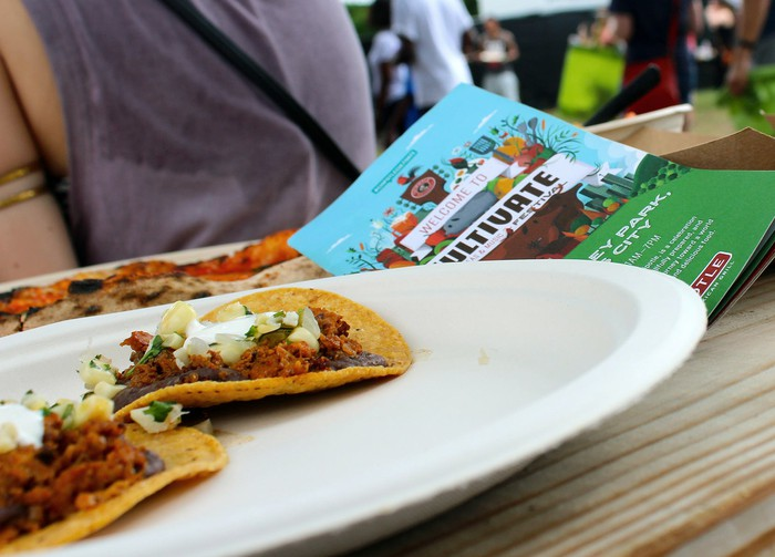 Plate with tostadas on a table next to a Chipotle flyer.