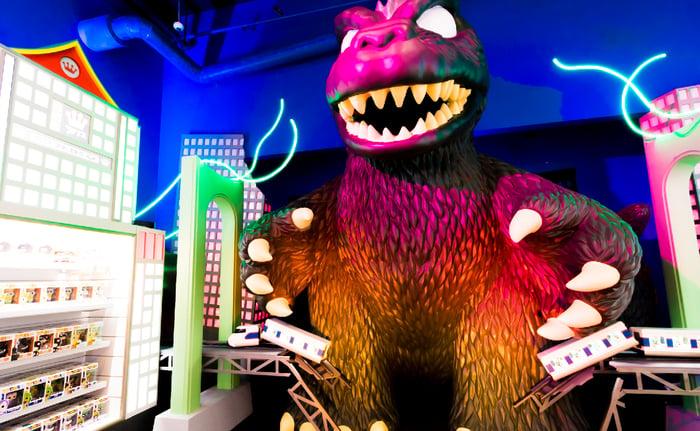 Funko product display beside life-sized Godzilla figure in Funko headquarters.
