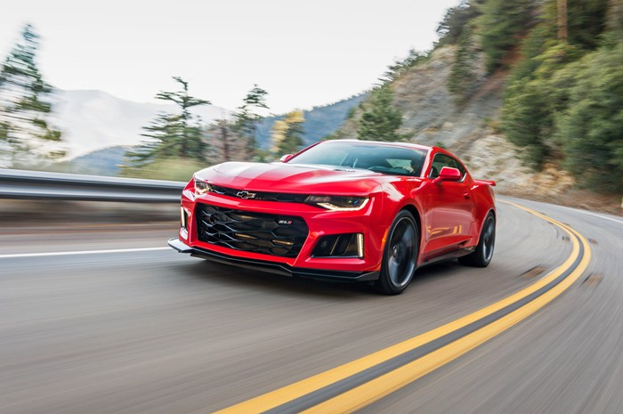 A 2018 Chevy Camaro ZL1 on a windy mountain road.