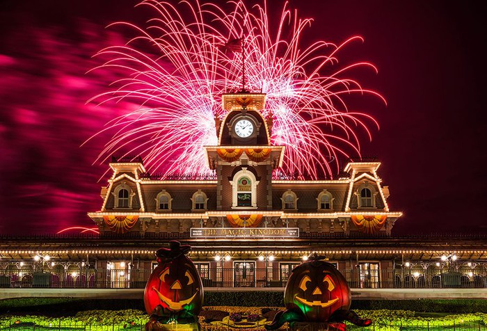 Fireworks over the Main Street Railroad station during Mickey's Not-So-Scary Halloween Party at Disney's Magic Kingdom.