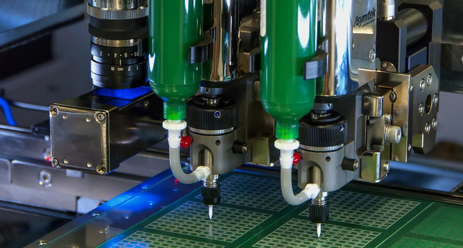 Glue machine dispensing on a semiconductor chip