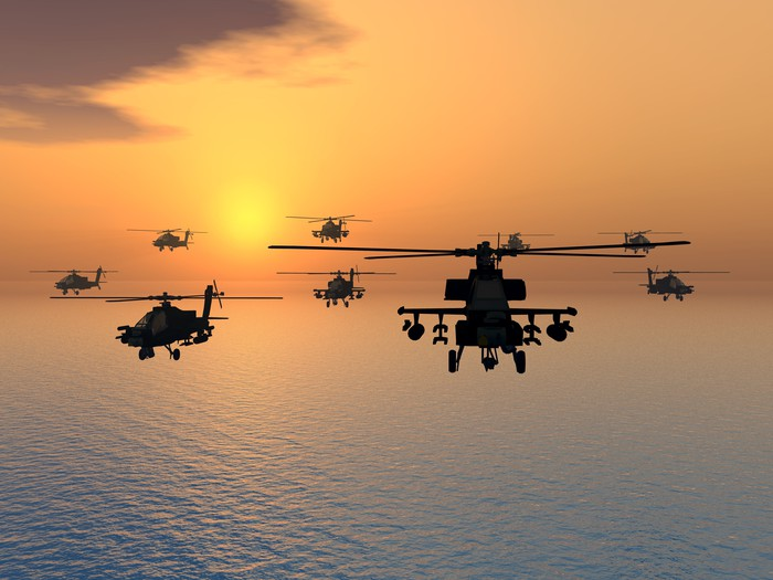 Military helicopters in flight.
