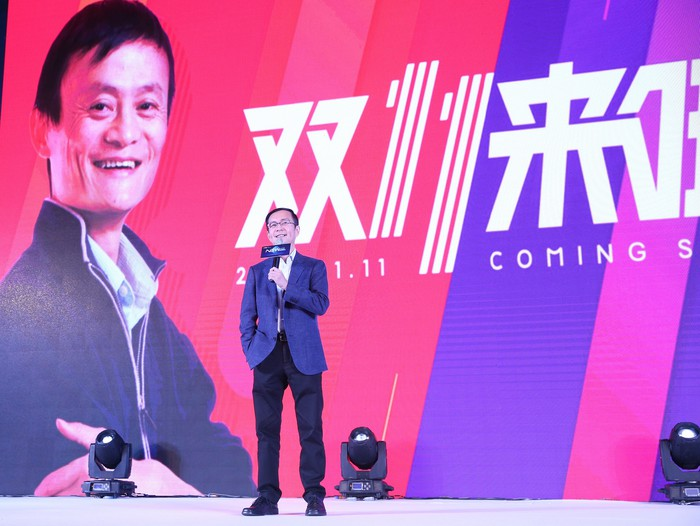 Alibaba CEO Jack Ma in the backdrop at a media presentation.