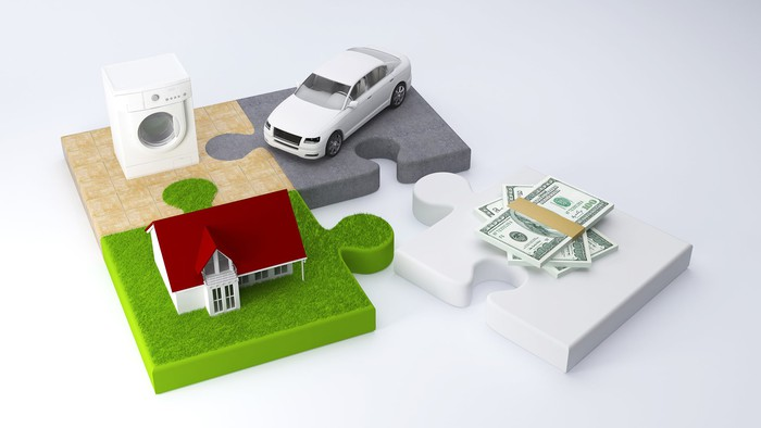 Puzzle pieces holding drier, car, and house separated from money.