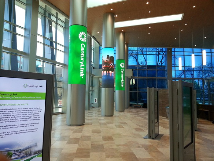 Lobby with vaulted ceilings and CenturyLink logos on the columns.