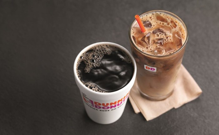 A cup of hot black coffee beside a glass of iced coffee.